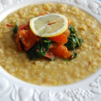 Garlic, Ginger and Lemon Lentil Soup with a Fresh Spinach and Tomato Topping