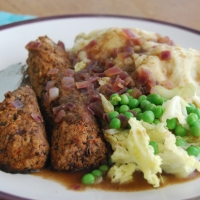 Thyme and Apple Beany Bangers and Mash with Onion Gravy, Cabbage and Peas